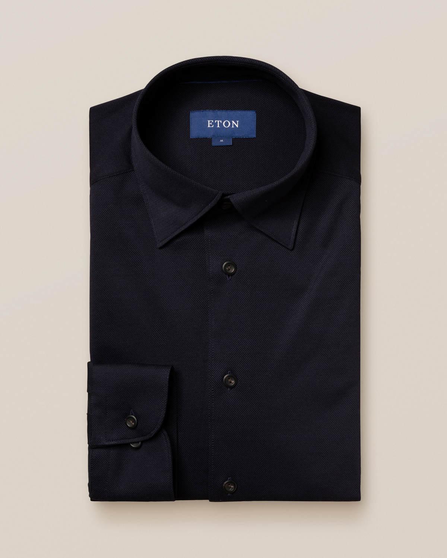 Mörkblå långärmad pikéskjorta