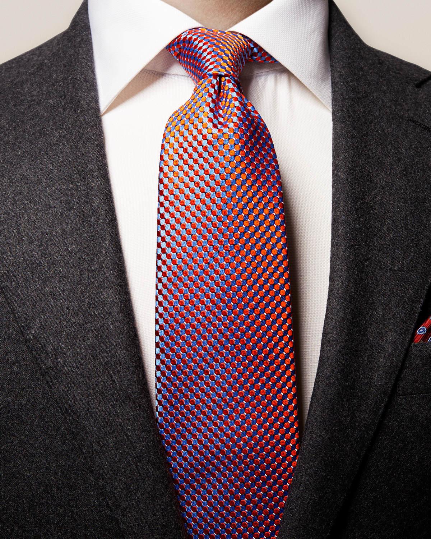 Orange sidenslips med geometriskt mönster