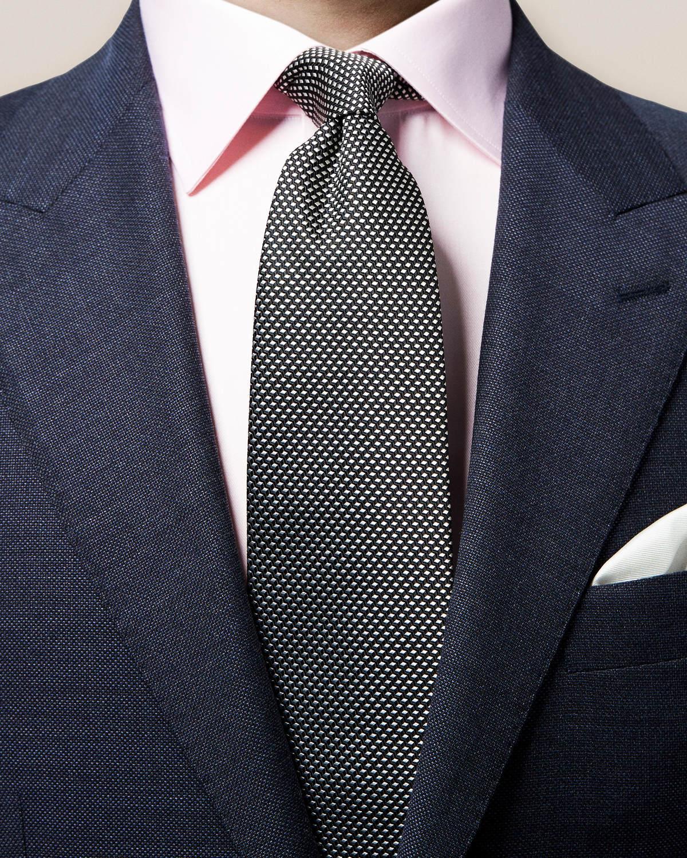 Svart vävd slips med geometriskt mönster