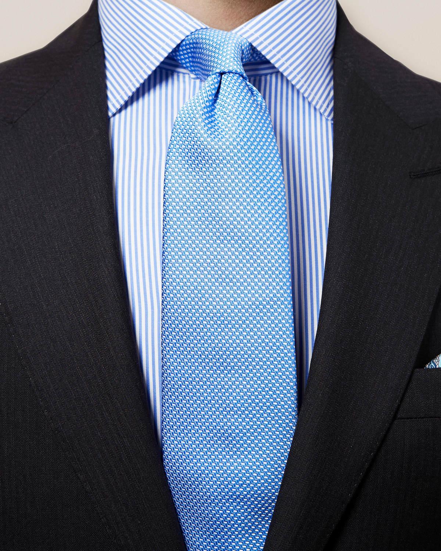 Blå vävd slips med geometriskt mönster