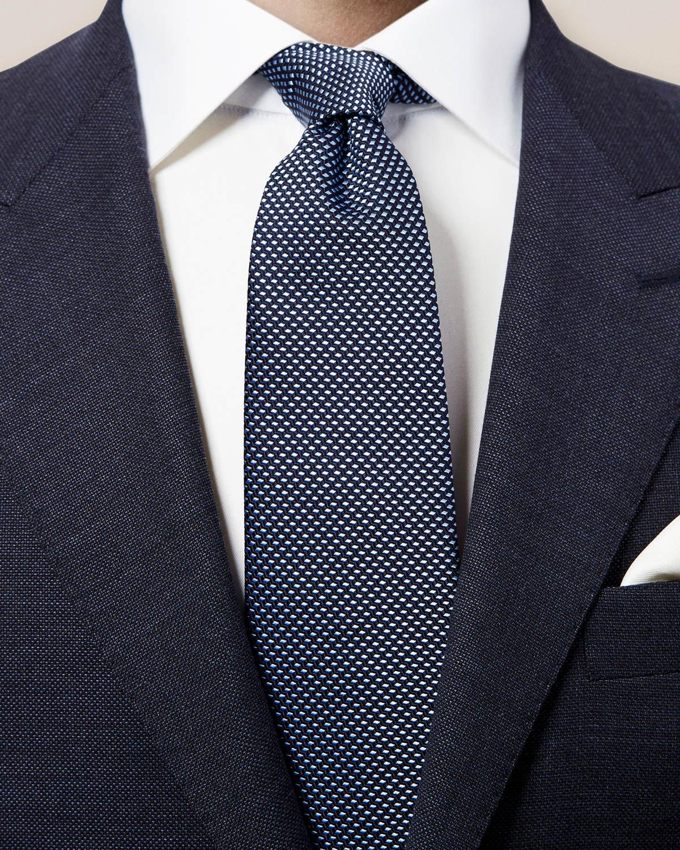 Mörkblå vävd slips med geometriskt mönster