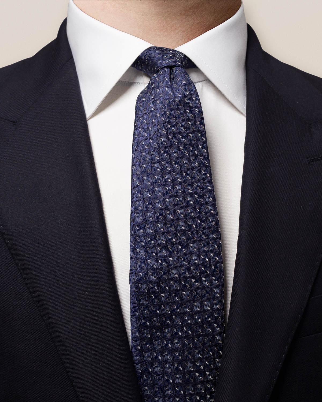 Mörkblå vävd slips med rutor