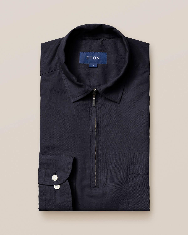 Mörkblå skjorta med kort dragkedja
