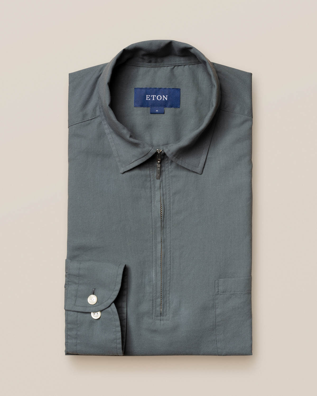 Mörkgrön skjorta med kort dragkedja