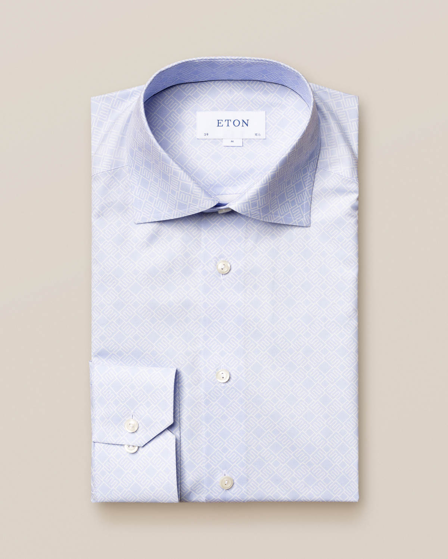 Blå skjorta med dubbelmonogram