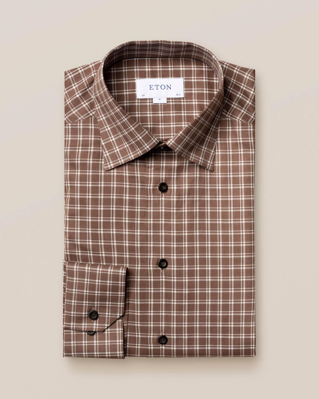 Brun och vit rutig flanellskjorta