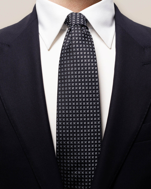 Svart slips med geometriskt blommönster