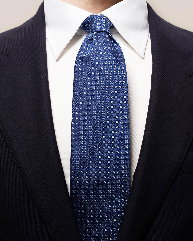 Marinblå slips med geometriskt blommönster