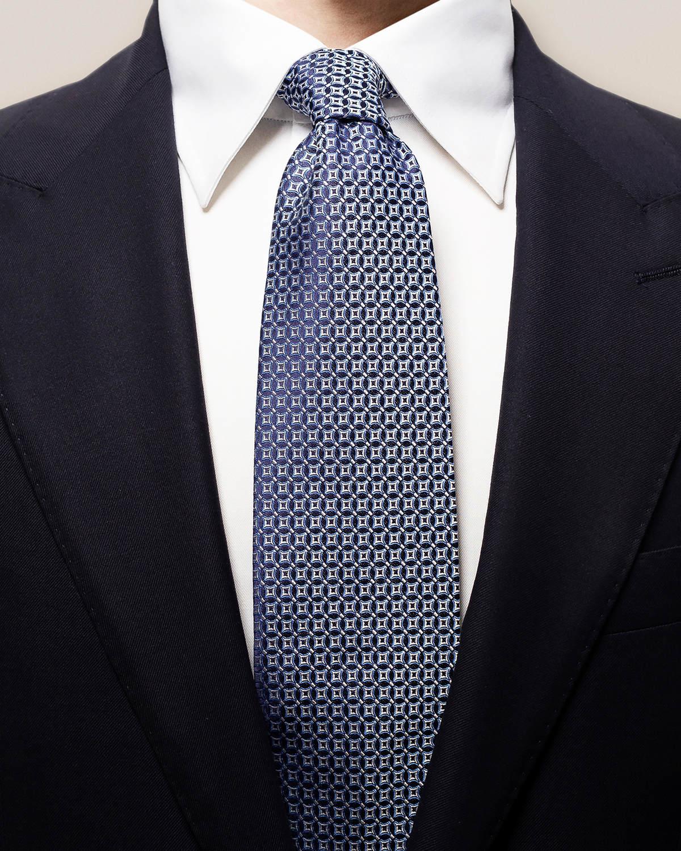 Marinblå slips med vävda blommor