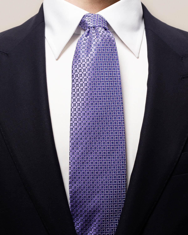 Lila slips med vävda blommor
