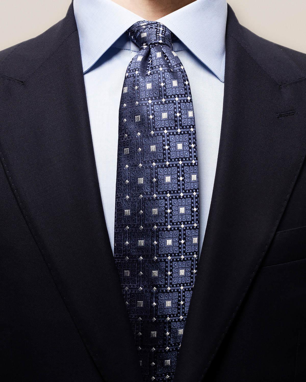 Grå och blå slips med geometriskt mönster