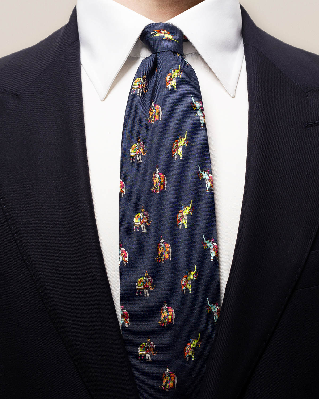 Marinblå slips med elefantmönster