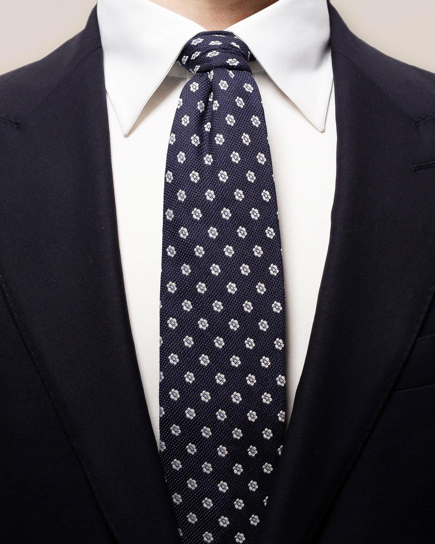 Marinblå slips i bomull och siden med blommor