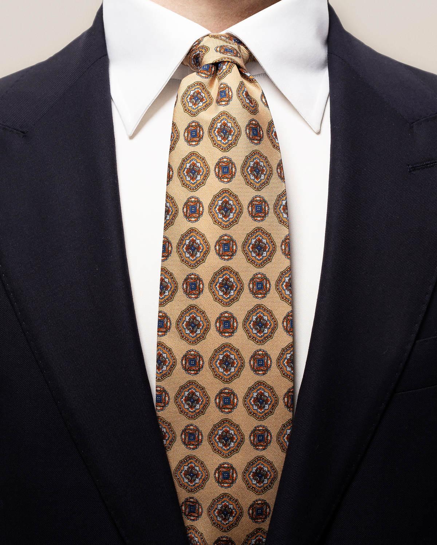 Beige dubbelmönstrad slips