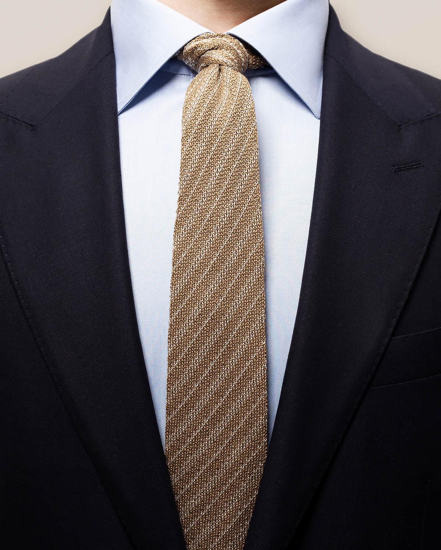 Beige stickad slips med ränder