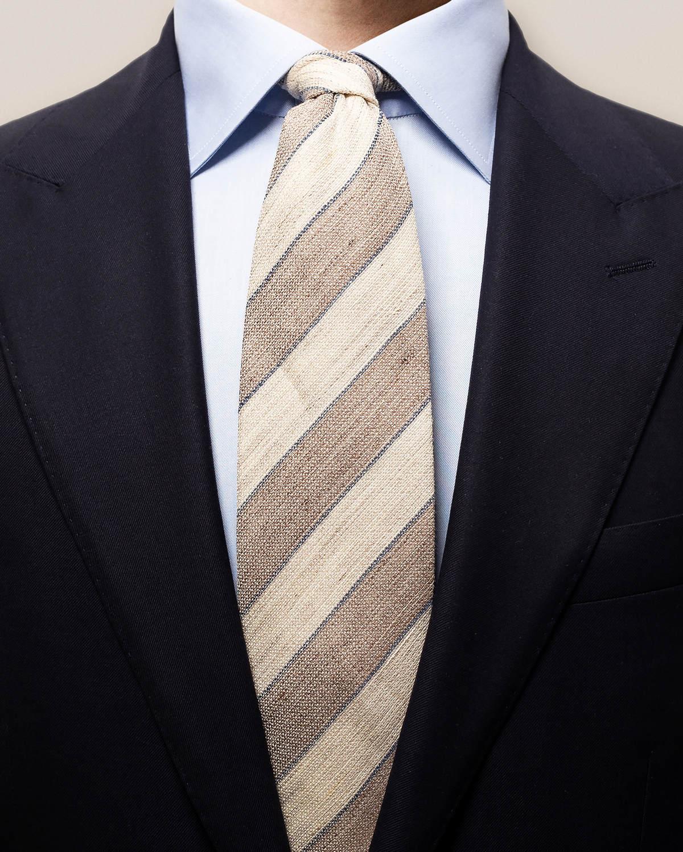 Beigerandig slips i blandmaterial