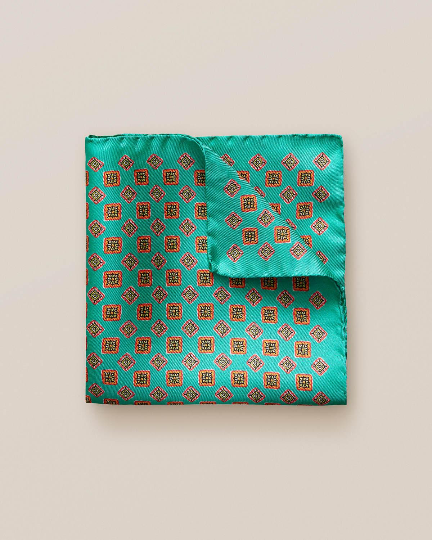 Grön näsduk med geometriskt mönster