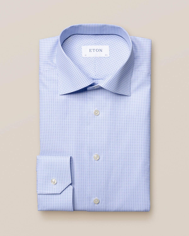 Blå skjorta med vävda rutor