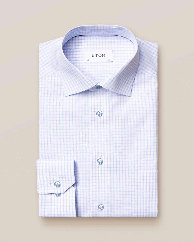 Ljusblå poplinskjorta med rutor