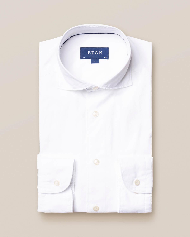 Vit dobbyskjorta med glänsande prickar – soft