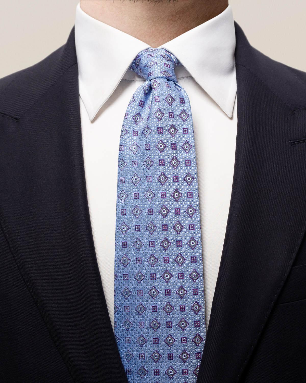 Blå slips med geometriskt kvadratmönster