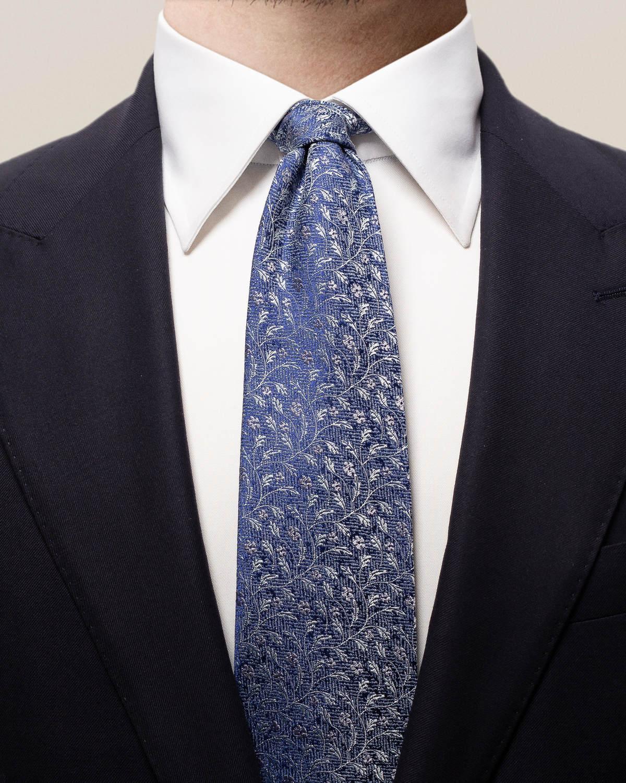 Blå slips med blommor
