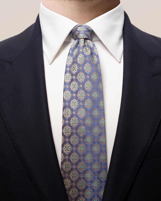 Blå medaljongmönstrad slips med kvadrater
